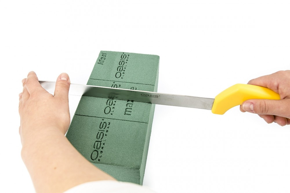 the oasis floral foam knife is an excellent aid to equal cuts of floral foam because of the long blade