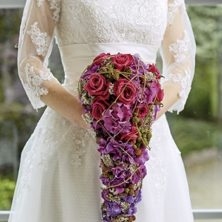 drop-shaped bridal bouquet with badges