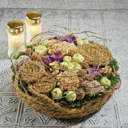 funeral floral arrangement with coconut cord